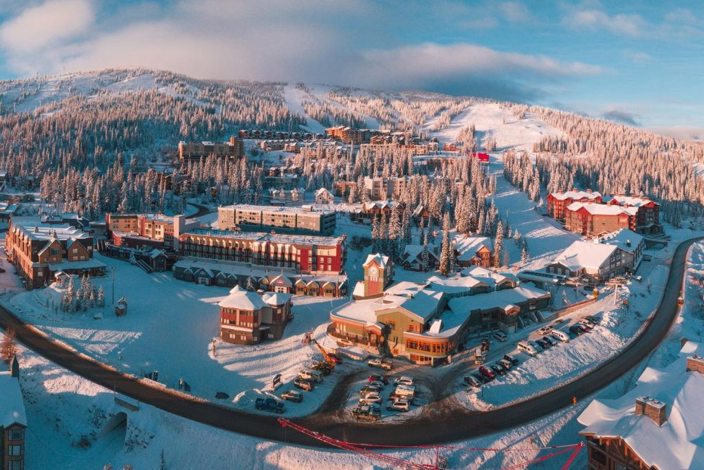 Aerial view of Big White Ski Resort's snow-bound village - Credit Big White Ski Resort