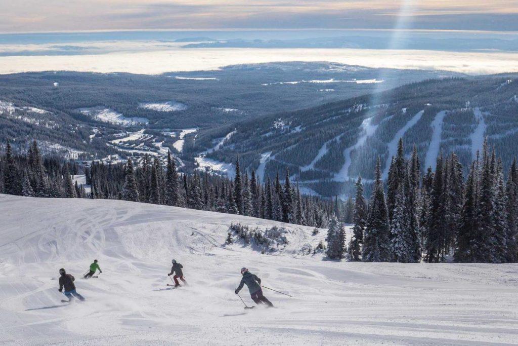 Sun Peaks people skiing in trail