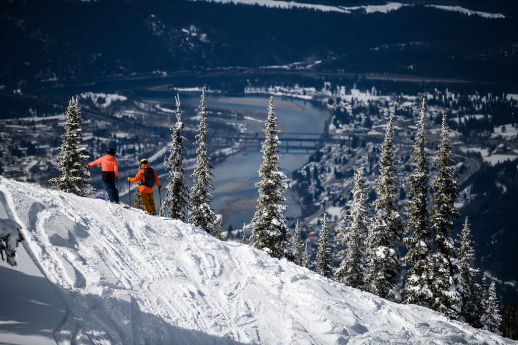 People skiing overlooking Revelstoke