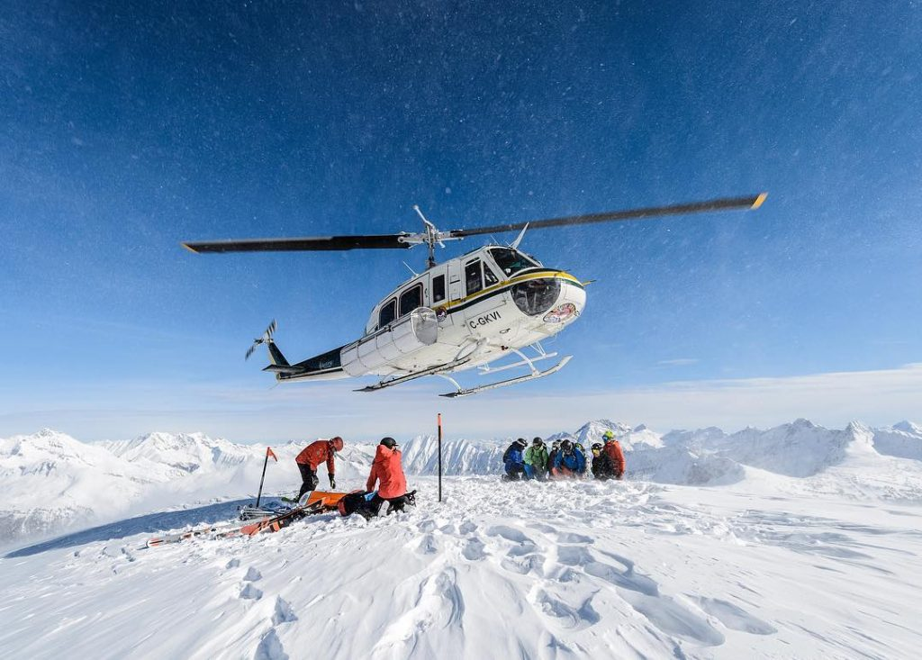 Revelstoke-Heli-group-with-chopper-Photo Credit-Selkirk-Tangiers